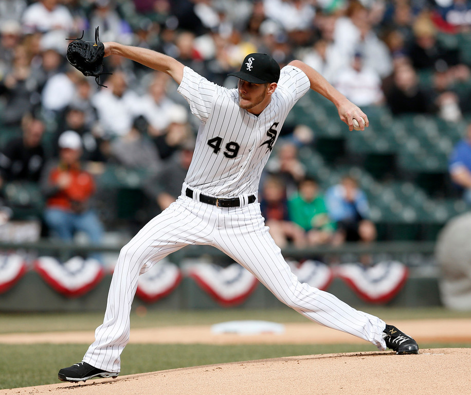 . Chicago White Sox starting pitcher Chris Sale delivers during the first inning of an Opening Day baseball game against the Minnesota Twins Monday, March 31, 2014, in Chicago. (AP Photo/Charles Rex Arbogast)