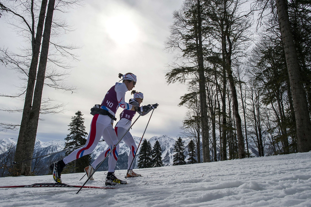 . Finland\'s Sami Jauhojaervi  (40) and Canada\'s Ivan Babikov (39) compete  in the Men\'s Cross-Country Skiing 15km Classic at the Laura Cross-Country Ski and Biathlon Center during the Sochi Winter Olympics on February 14, 2014 in Rosa Khutor near Sochi. ODD ANDERSEN/AFP/Getty Images