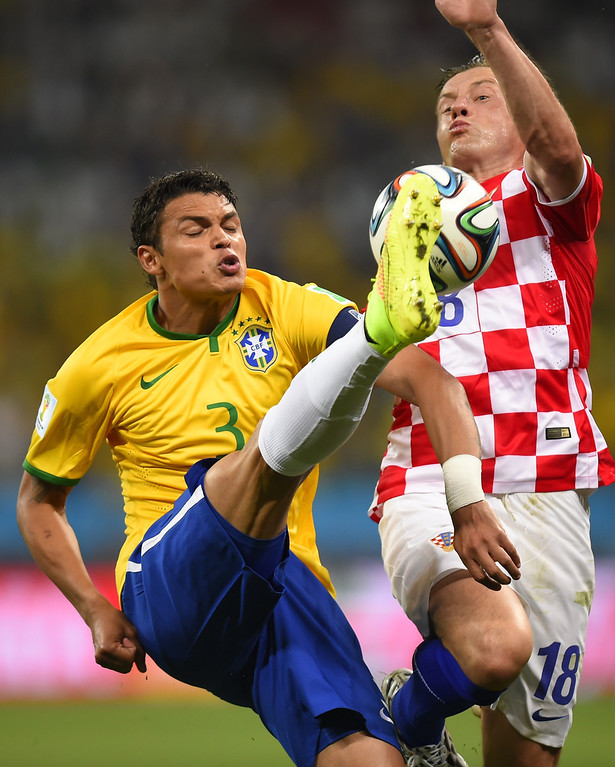 . Brazil\'s defender and captain Thiago Silva (L) and Croatia\'s forward Ivica Olic vie for the ball during a Group A football match between Brazil and Croatia at the Corinthians Arena in Sao Paulo during the 2014 FIFA World Cup on June 12, 2014. AFP PHOTO / FABRICE COFFRINI/AFP/Getty Images