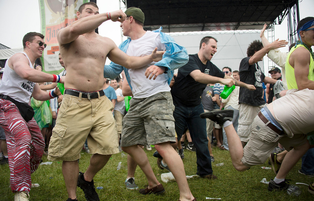 ". Young men ""mosh\"" dance during the rock band Chevelle\'s show prior to the 138th running of the Preakness Stakes at Pimlico Race Course on May 18, 2013 in Baltimore, Maryland. JIM WATSON/AFP/Getty Images"