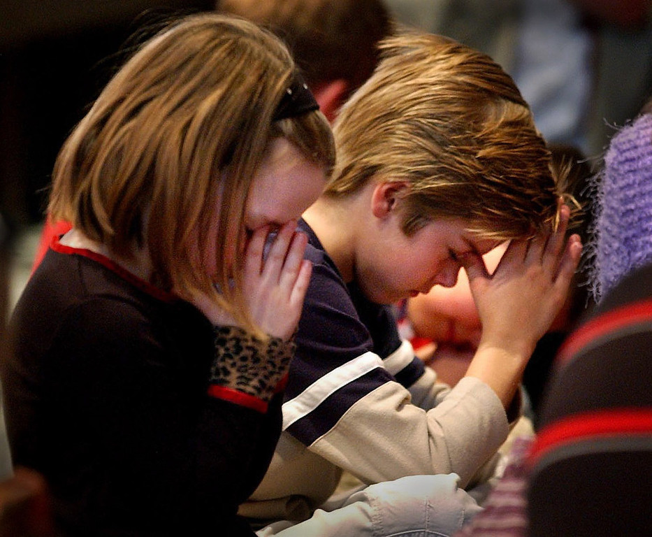 . Young Mandy Brown, 5, and Spencer Isern, right, say a prayer for those lost on the Shuttle Columbia during a sunday morning church service at First Presbyterian Church in Amarillo, Texas, FEBRUARY 2, 2003.  The entire service was dedicated to Space Shuttle Columbia\'s Astronaut and Commander Rick Douglas Husband, whose hometown was Amarillo.  His wife Evelyn used to attend this church and her family still does.  Husband often sang with the choir.  Husband perished in the Columbia disaster early saturday morning.  He leaves behind his wife Evelyn and two kids Laura and Matthew.    The last time Husband was in Amarillo he spoke at First Presbyterian and talked about his lifelong dream of becoming an astronaut.  The service replayed the speech in it\'s entirety making for an emotional and tearful service amongst the congregation, who all felt a deep sense of loss with the passing of Husband and the other six astronauts on board the Shuttle.  HELEN H. RICHARDSON, The Denver Post