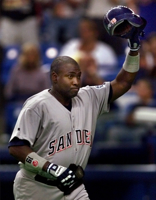 . San Diego Padres\' Tony Gwynn acknowledges the crowd as he leaves the game in the eighth inning against the Montreal Expos Friday, Aug., 6, 1999. Gwynn singled in the first inning to become the 22nd major leaguer to have 3,000 career hits. He finished the game 4 for 5 with one run and a total of 3,003 hits.(AP Photo/Michael S. Green)