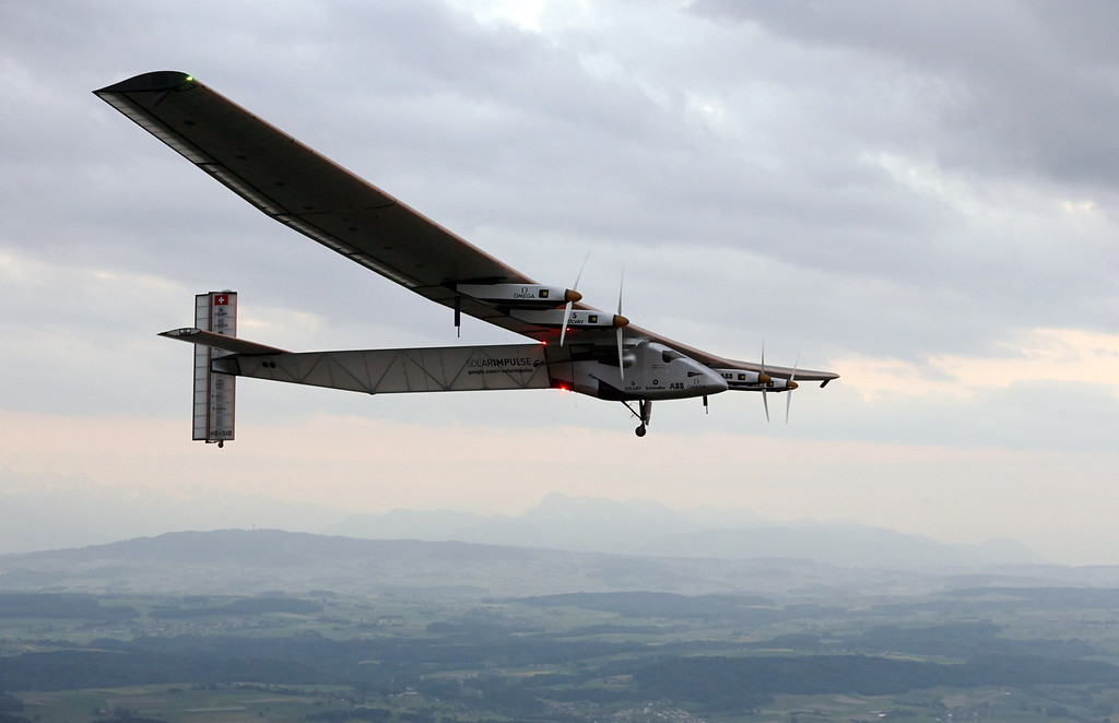 . German test pilot Markus Scherdel steers the solar-powered Solar Impulse 2 aircraft for its maiden flight at its base in Payerne on June 2, 2014. The aircraft, which was unveiled on April 9, 2014 weighs 2.4 tons with a wingspan of 72 meter and more than 17,000 solar cells. The attempt to fly around the world in stages using only solar energy will be made in 2015.  AFP PHOTO / POOL / DENIS  BALIBOUSE/AFP/Getty Images