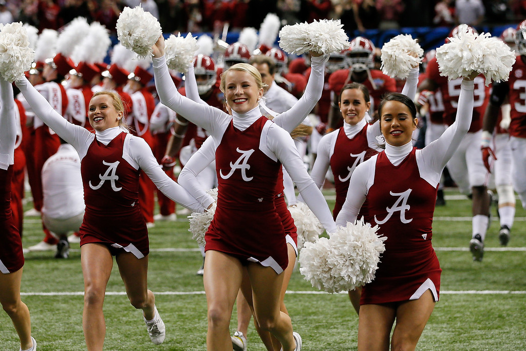 . NEW ORLEANS, LA - JANUARY 02:  Cheerleaders for the Alabama Crimson Tide run on the field during the Allstate Sugar Bowl at the Mercedes-Benz Superdome on January 2, 2014 in New Orleans, Louisiana.  (Photo by Kevin C. Cox/Getty Images)