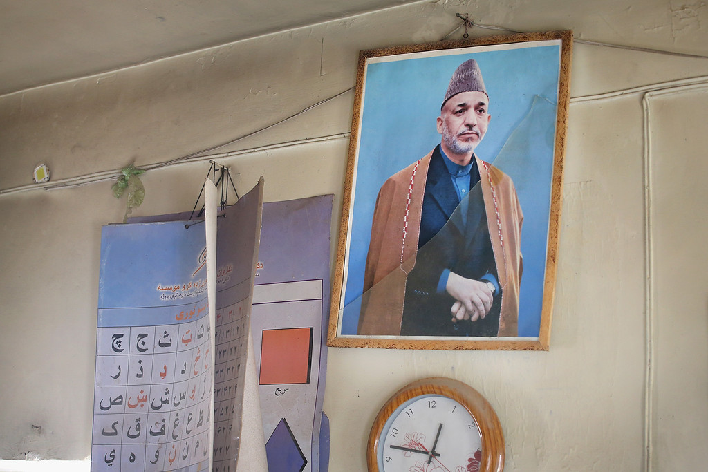 . KANDAHAR, AFGHANISTAN - MARCH 09:  A picture of Afghan President Hamid Karzai with broken glass hangs on the wall in an Afghan National Police (ANP) outpost on March 9, 2014 near Kandahar, Afghanistan.  President Obama recently ordered the Pentagon to begin contingency planning for a pullout from Afghanistan by the end of 2014 if  Karzai or his successor refuses to sign the Bilateral Security Agreement.  (Photo by Scott Olson/Getty Images)