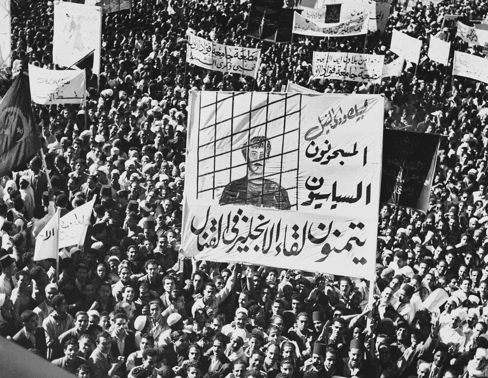 . A huge banner demanding release of political prisoners is carried by Egyptians in a procession through Cairo streets on Nov. 14, 1951 as a three-day \'Hate Britain\' campaign is started. It is part of the Egyptian attempt to get the British out of Egypt and the Egyptians into the Sudan. Most of the political prisoners are members of the Moslem Brotherhood. (AP Photo)