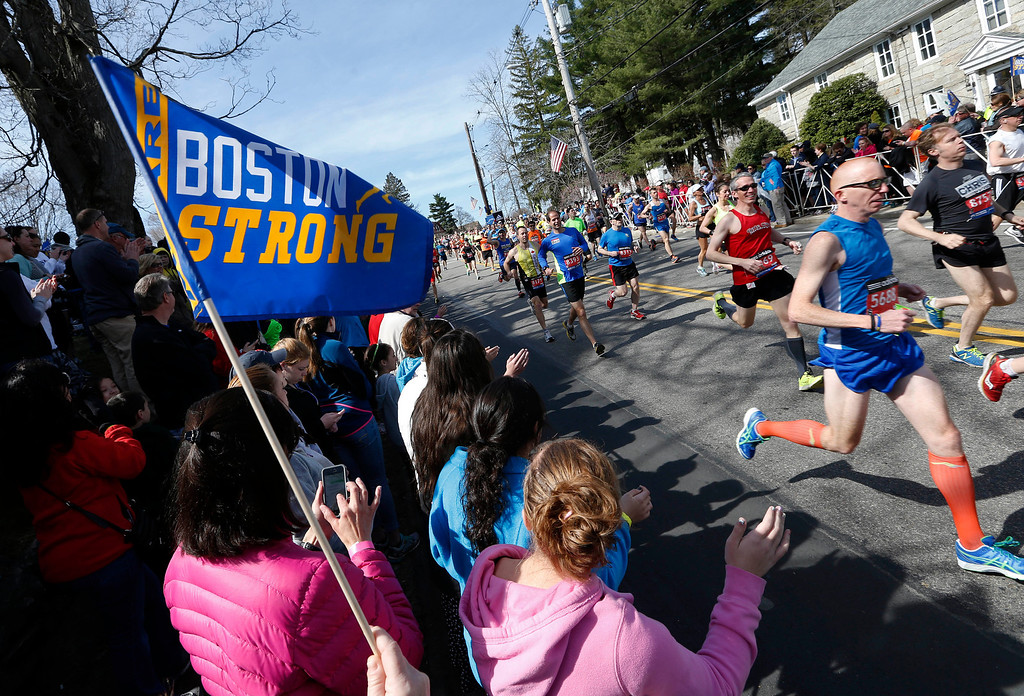 . Race fans cheer runners as they start the 118th Boston Marathon Monday, April 21, 2014. in Hopkinton, Mass. (AP Photo/Michael Dwyer)