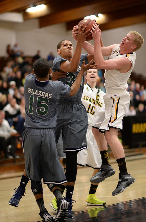 . CENTENNIAL, CO. JANUARY 18: Ryan Swan of Overland High School (34), front center, and Brendan Till of Arapahoe High School (13), right, are fighting for the free ball by Austin Conway of Overland High School (15), left, and Corbin Atwell of Arapahoe High School (10) in the 2nd half of the game at Arapahoe High School. Centennial Colorado. January 18. 2014. Arapahoe won 62-54.  (Photo by Hyoung Chang/The Denver Post)