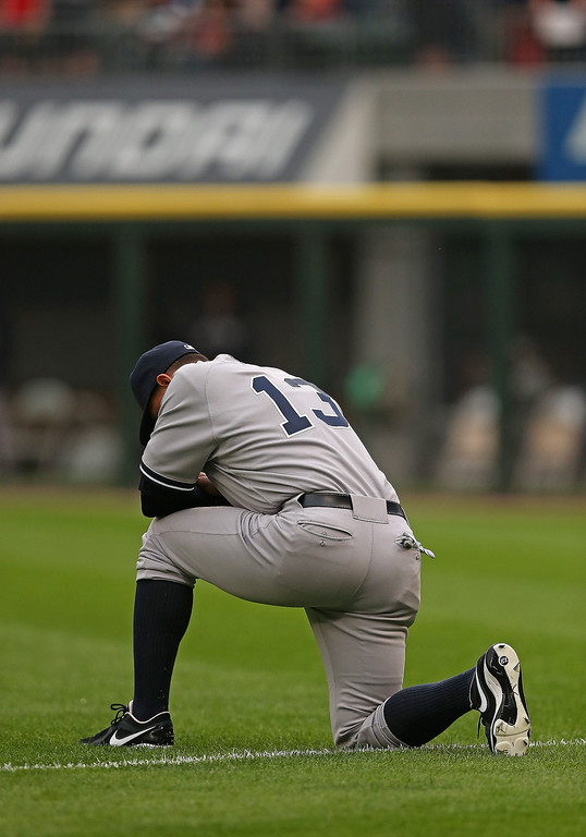 . Alex Rodriguez #13 of the New York Yankees takes a moment to himself before a game against the Chicago White Sox at U.S. Cellular Field on August 5, 2013 in Chicago, Illinois.  (Photo by Jonathan Daniel/Getty Images)