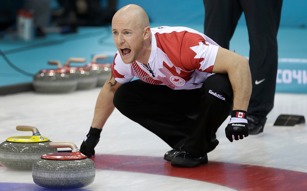 . Canada\'s Ryan Fry shouts instructions to his teammates during the men\'s curling competition against the United States at the 2014 Winter Olympics, Sunday, Feb. 16, 2014, in Sochi, Russia. (AP Photo/Wong Maye-E)