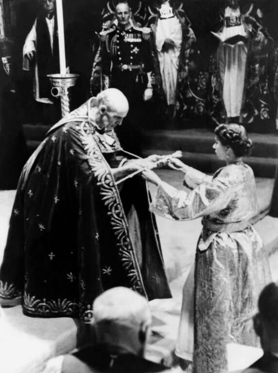 . In this file picture taken on June 2, 1953 The then Archbishop of Canterbury Geoffrey Fisher presents Britain\'s Queen Elizabeth II with a sword, prior to the Coronation ceremony in London.  Queen Elizabeth II marked the 60th anniversary of her coronation on June 4, 2013 with a service at Westminster Abbey filled with references to the rainy day in 1953 when she was crowned.  FILES/AFP/Getty Images