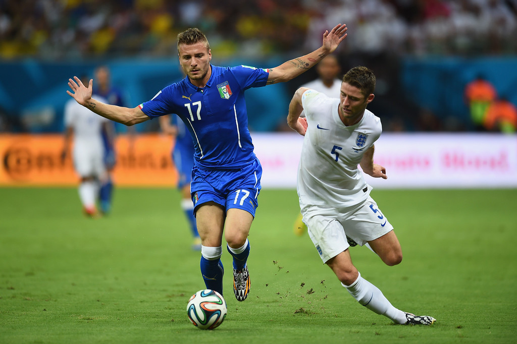 . Ciro Immobile of Italy and Gary Cahill of England battle for the ball during the 2014 FIFA World Cup Brazil Group D match between England and Italy at Arena Amazonia on June 14, 2014 in Manaus, Brazil.  (Photo by Christopher Lee/Getty Images)