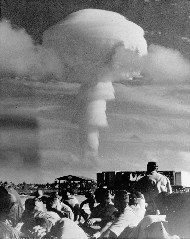. Russia continued testing of giant nuclear explosions in the atmosphere so the United States resumed its own tests.  The now familiar atomic explosion mushroom rose over Christmas Island in the Equatorial Pacific during U.S. experiments.  This bomb was exploded from a plane.  (AP Photo/Oakland Tribune)