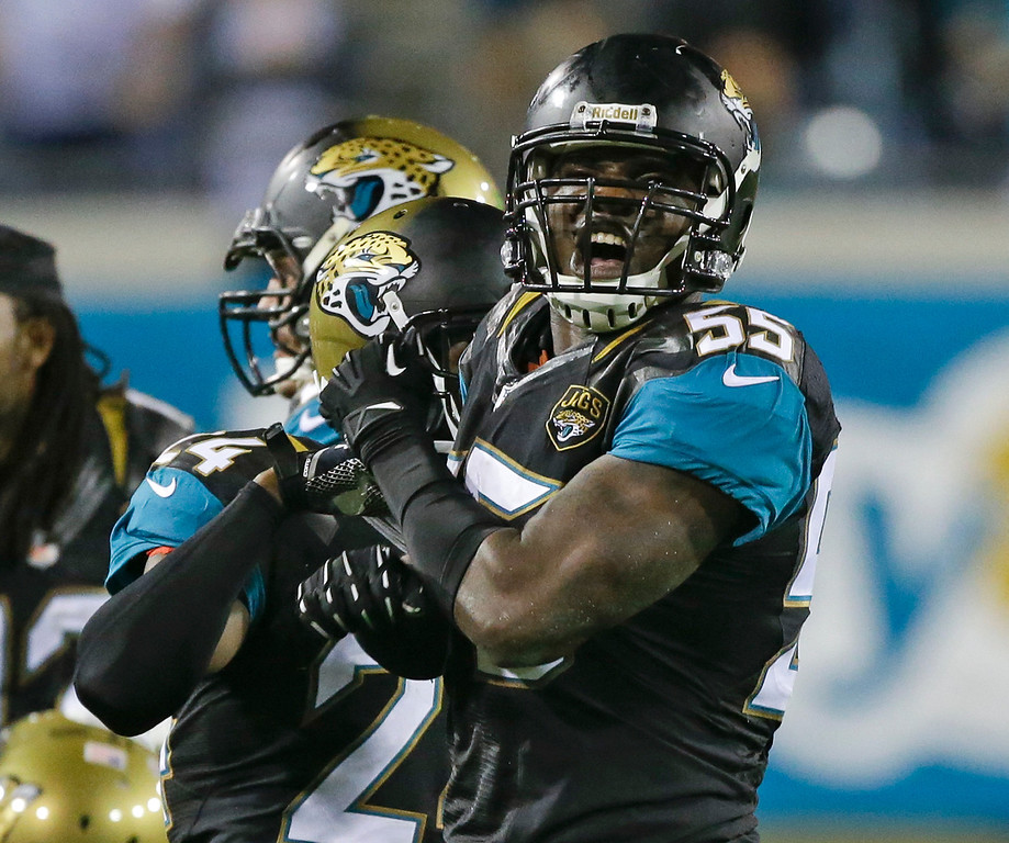. Jacksonville Jaguars outside linebacker Geno Hayes (55) celebrates a Houston Texans interception late in during the an NFL football game to give the Jaguars a 27-20 victory in Jacksonville, Fla., Thursday, Dec. 5, 2013.(AP Photo/John Raoux)