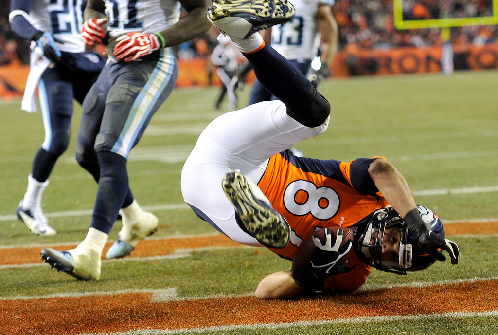 . Denver Broncos wide receiver Eric Decker (87) rolls into the end zone for a fourth quarter touchdown.  The Broncos beat the Titans 51 -28. (Photo by Joe Amon/The Denver Post)