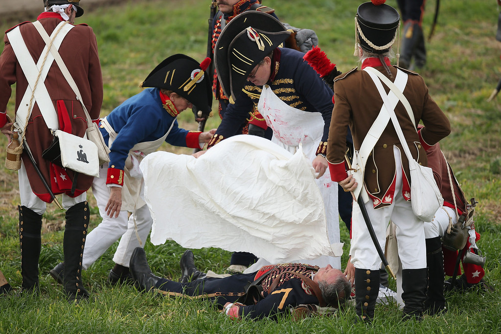 . Historical society enthusiasts in the role of troops loyal to Napoleon tend to a fictitiously fallen comrade during the re-enactment of The Battle of Nations on its 200th anniversary on October 20, 2013 near Leipzig, Germany.  (Photo by Sean Gallup/Getty Images)