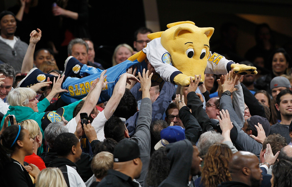 . Rocky the mountain lion, the mascot of the Denver Nuggets, is passed along by fans as the Nuggets host the Chicago Bulls in the first quarter of an NBA basketball game in Denver on Thursday, Feb. 7, 2013. (AP Photo/David Zalubowski)