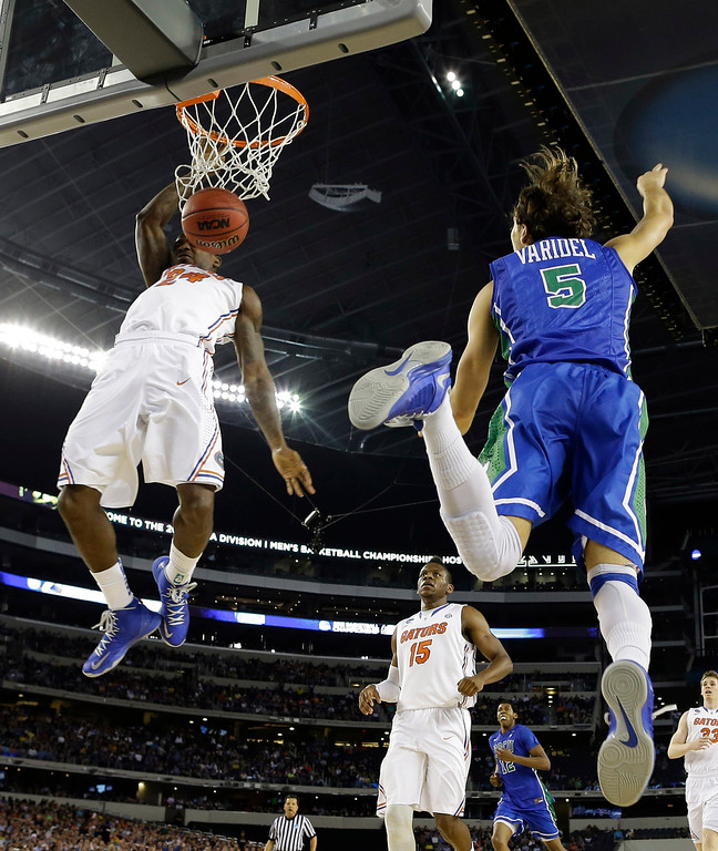 . Florida\'s Casey Prather (24) dunks as Florida Gulf Coast\'s Christophe Varidel (5) defends during the first half of a regional semifinal game in the NCAA college basketball tournament, Friday, March 29, 2013, in Arlington, Texas. (AP Photo/David J. Phillip)
