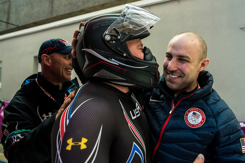 . USA\'s pilot Steven Holcomb celebrates with USA bobsled Head Coach Brian Shimer and Nick Cunningham after the four-man bobsled at Sanki Sliding Center during the 2014 Sochi Olympics Sunday February 23, 2014. They won the bronze medal with a cumulative time of 3:40.99. 