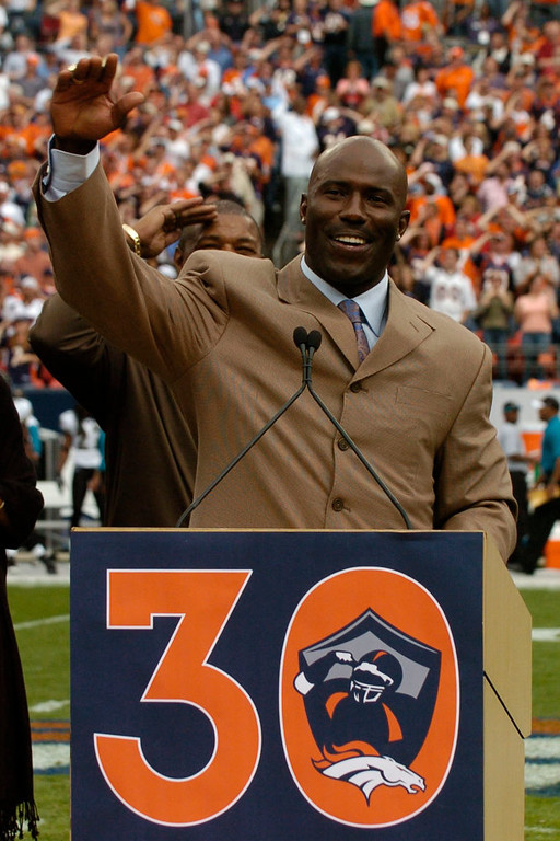 . Former Denver Bronco Terrell Davis give his final salute during half time after being inducted into the ring of fame on Sunday September 23rd at Invesco Field at Mile High in Denver, CO.  Photo by John Leyba / The Denver Post