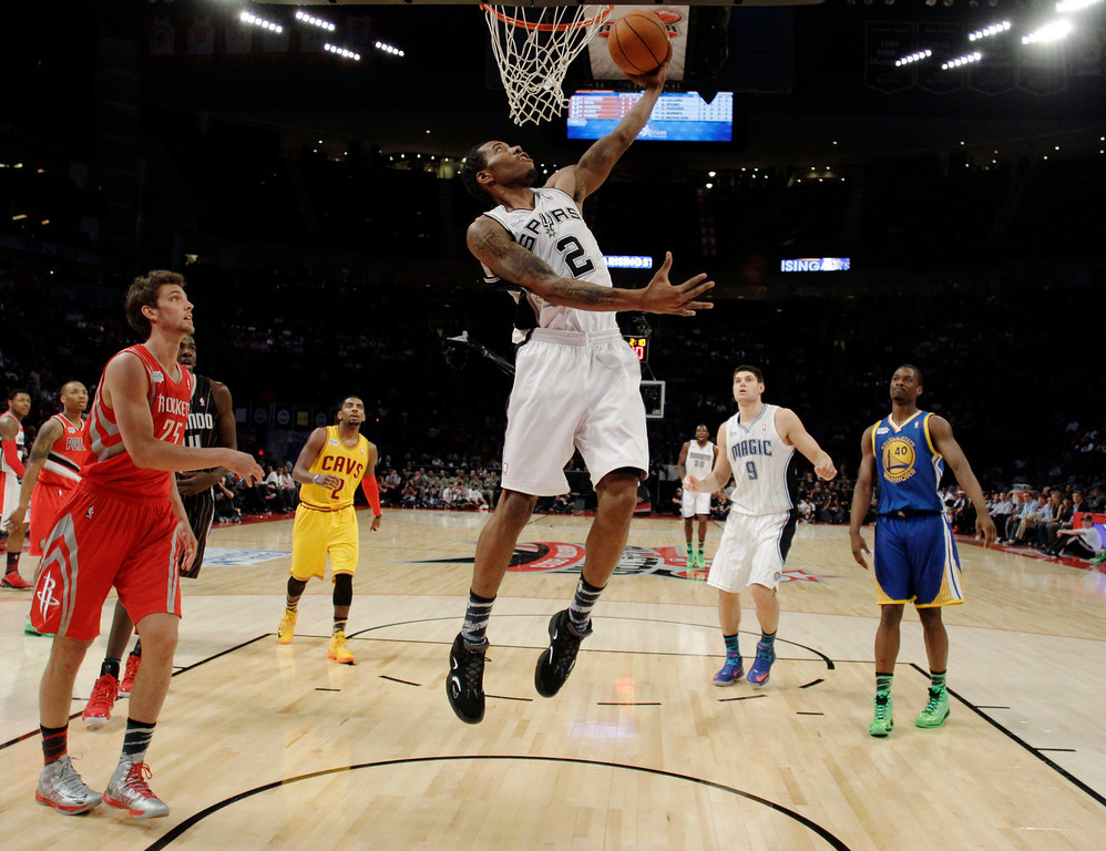 . Team Chuck\'s Kawhi Leonard of the San Antonio Spurs shoots against Team Shaqduring the first half of the Rising Stars Challenge basketball game at NBA All-Star Weekend, Friday, Feb. 15, 2013, in Houston. (AP Photo/Eric Gay)