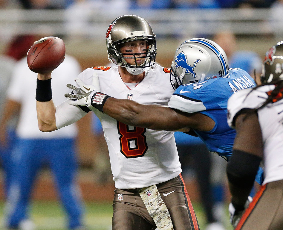 . Ezekiel Ansah #94 of the Detroit Lions sacks Mike Glennon #8 of the Tampa Bay Buccaneers in the first quarter at Ford Field on November 24, 2013 in Detroit, Michigan. (Photo by Gregory Shamus/Getty Images)