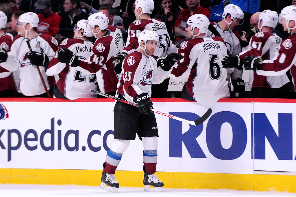 . MONTREAL, QC - MARCH 18:  Maxime Talbot #25 of the Colorado Avalanche celebrates his second-period goal with teammates during the NHL game against the Montreal Canadiens at the Bell Centre on March 18, 2014 in Montreal, Quebec, Canada.  (Photo by Richard Wolowicz/Getty Images)