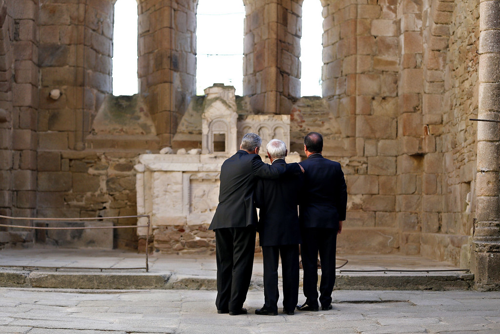 . French President Francois Hollande (R) and his German counterpart Joachim Gauck (L) visit on September 4, 2013 the ruins of the church of Oradour-sur-Glane with Robert Hebras, 88, one of the last survivors of the World War II massacre in the central French village. The town has become a ghostly war crimes museum since Nazi troops burnt it to the ground on June 10, 1944. Six hundred and forty-two original inhabitants were massacred in Oradour and no one knows exacty why. Women and chldren were massacred in the church before their bodies were burnt by a German SS division. Hebras is one of three survivors still alive. YOAN VALAT/AFP/Getty Images