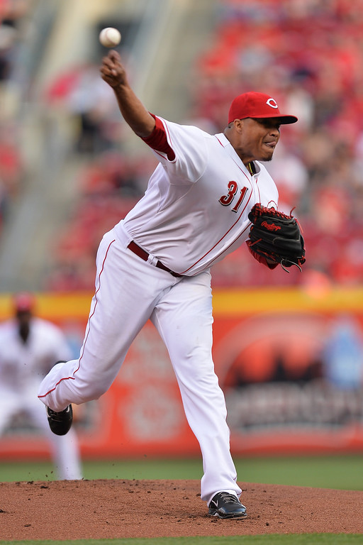 . CINCINNATI, OH - MAY 10:  Alfredo Simon #31 of the Cincinnati Reds pitches to the Colorado Rockies in the first inning at Great American Ball Park on May 10, 2014 in Cincinnati, Ohio.  (Photo by Jamie Sabau/Getty Images)