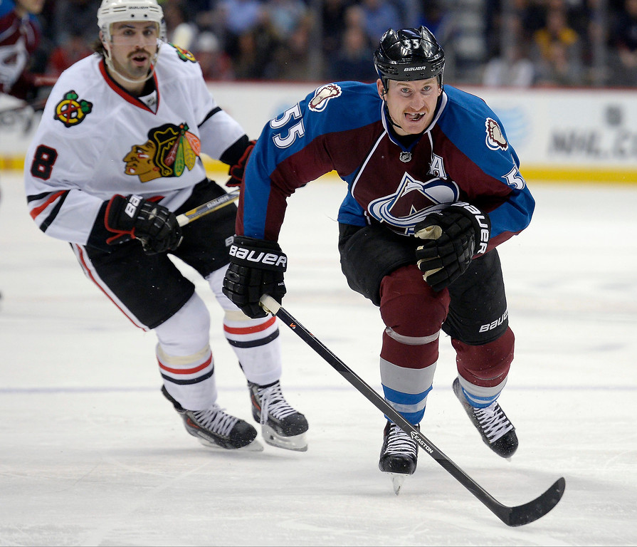 . Colorado Avalanche left wing Cody McLeod (55) races to the puck in the Chicago Blackhawks zone during the first period November 19, 2013 at Pepsi Center. (Photo by John Leyba/The Denver Post)