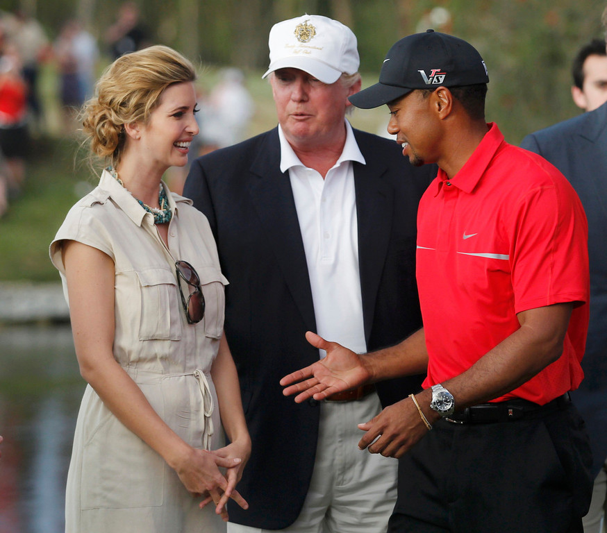 . Tiger Woods is congratulated by Donald Trump and his daughter Evanka after winning the 2013 WGC-Cadillac Championship PGA golf tournament in Doral, Florida March 10, 2013. REUTERS/Andrew Innerarity