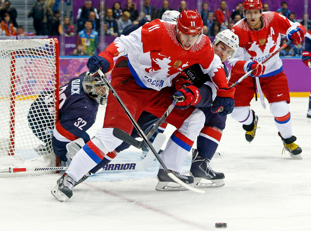 . Russia forward Yevgeni Malkin seals off the puck from USA defenseman Ryan McDonagh in the first period of a men\'s ice hockey game at the 2014 Winter Olympics, Saturday, Feb. 15, 2014, in Sochi, Russia. (AP Photo/Mark Humphrey)