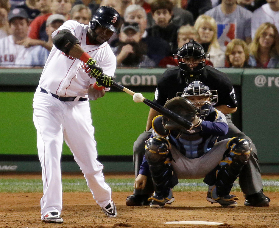 . Boston Red Sox designated hitter David Ortiz hits his second home run of the game off Tampa Bay Rays starting pitcher David Price, in front of Rays catcher Jose Molina in the eighth inning in Game 2 of baseball\'s American League division series Saturday, Oct. 5, 2013, in Boston. (AP Photo/Stephan Savoia)