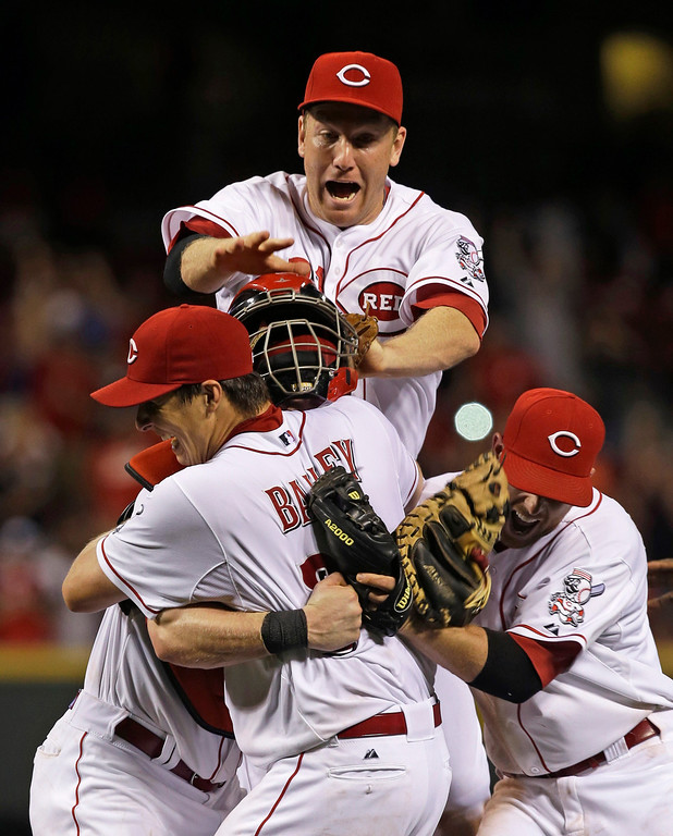 . Cincinnati Reds starting pitcher Homer Bailey is mobbed after no-hitting the San Francisco Giants in a baseball game, Tuesday, July 2, 2013, in Cincinnati. (AP Photo/Al Behrman)