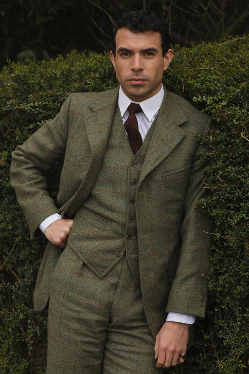 """. Tom Cullen as Lord Gillingham. The fourth season of \""""Downton Abbey\"""", set in 1922, sees the return of our much loved characters. As they face new challenges, the Crawley family and the servants who work for them remain inseparably interlinked.   (Photo by Nick Briggs/Carnival Films & Television Limited 2013 for MASTERPIECE)"""