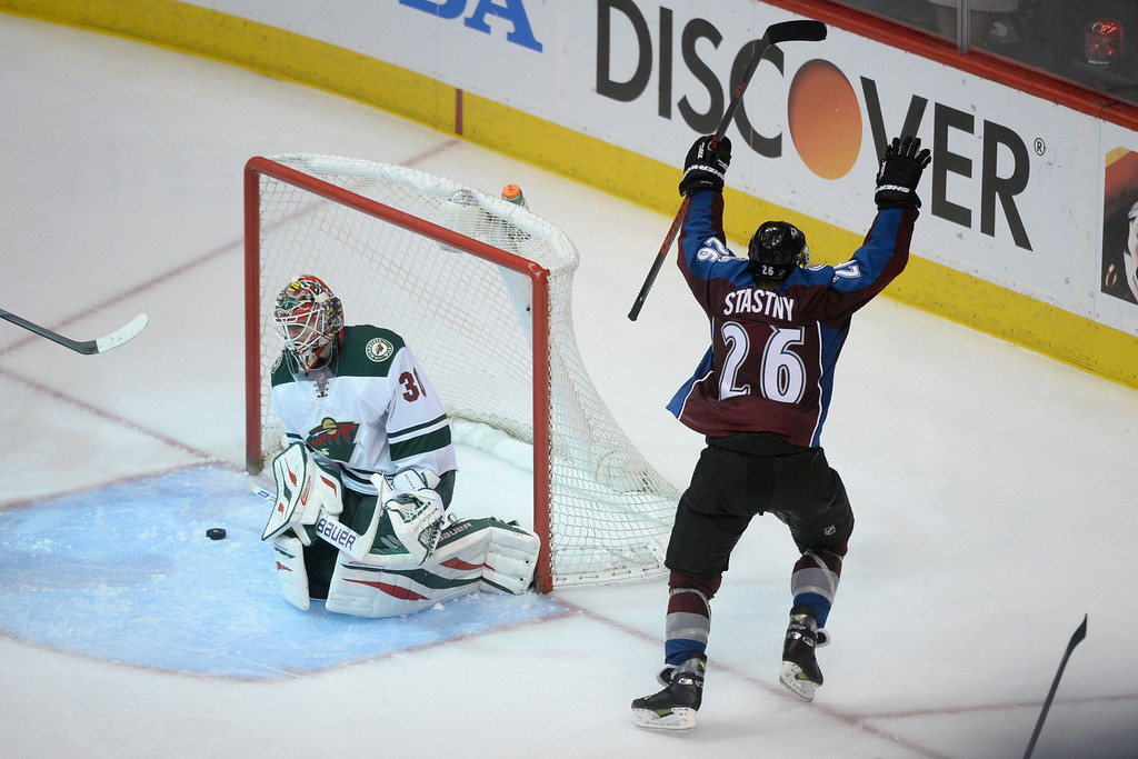 . DENVER, CO - APRIL 17: Paul Stastny (26) of the Colorado Avalanche celebrates his game-winning goal as Ilya Bryzgalov (30) of the Minnesota Wild reacts during the overtime period of the Avs\' 5-4 win. The Colorado Avalanche hosted the Minnesota Wild during the first round of the NHL Stanley Cup Playoffs at the Pepsi Center on Thursday, April 17, 2014. (Photo by Karl Gehring/The Denver Post)
