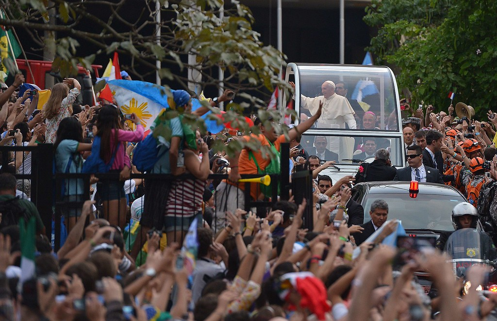 . Pope Francis waves at faithfuls from the popemobile on his way to the Guanabara Palace after his arrival in Rio de Janeiro on July 22, 2013.   AFP PHOTO / GABRIEL  BOUYS/AFP/Getty Images