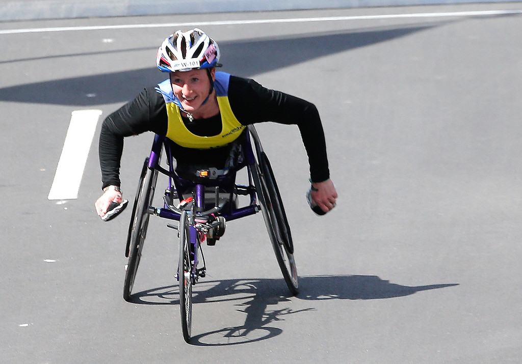 . Tatyana McFadden celebrates as she wins the women\'s wheelchair division of the 2014 B.A.A. Boston Marathon on April 21, 2014 in Boston, Massachusetts.  (Photo by Jim Rogash/Getty Images)