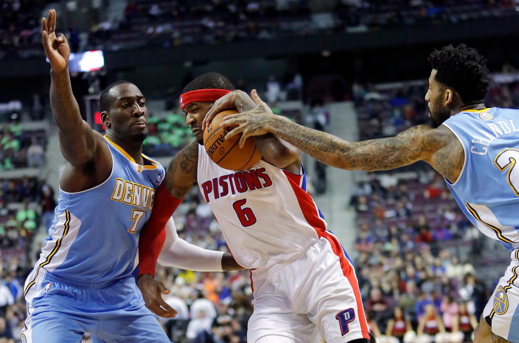 . Detroit Pistons forward Josh Smith (6) is fouled while driving to the basket against Denver Nuggets forward Wilson Chandler, right, and center JJ Hickson (7) during the second half of an NBA basketball game on Saturday, Feb. 8, 2014, in Auburn Hills, Mich. The Pistons won 126-109. (AP Photo/Duane Burleson)