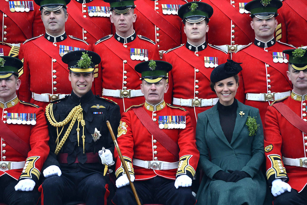 . Britain\'s Catherine, Duchess of Cambridge, and her husband, Prince William (Front 2nd L), pose for an official photograph as they attend St Patrick\'s Day Parade at Mons Barracks in Aldershot, southern England, on March 17, 2013.  Prince William attended the Parade as Colonel of the Regiment, and the Duchess presented the traditional sprigs of shamrocks to the Officers and Guardsmen of the Regiment.  TOBY MELVILLE/AFP/Getty Images