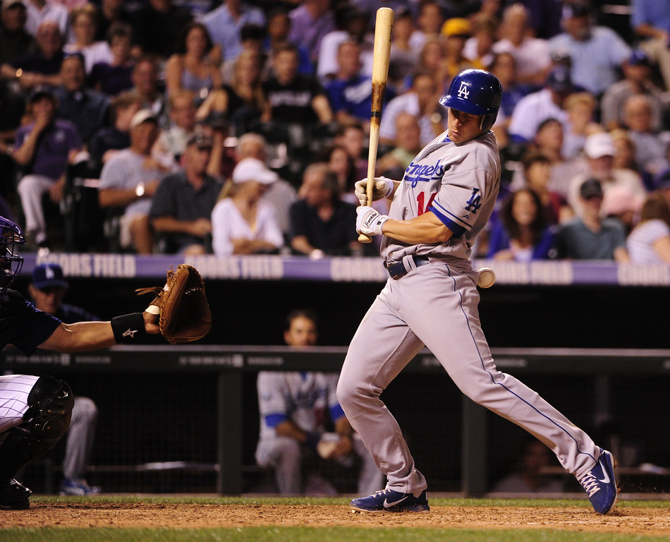 . Los Angeles Dodgers batter Mark Ellis gets beaned during a game at Coors Field on Monday, August 27, 2012. AAron Ontiveroz, The Denver Post