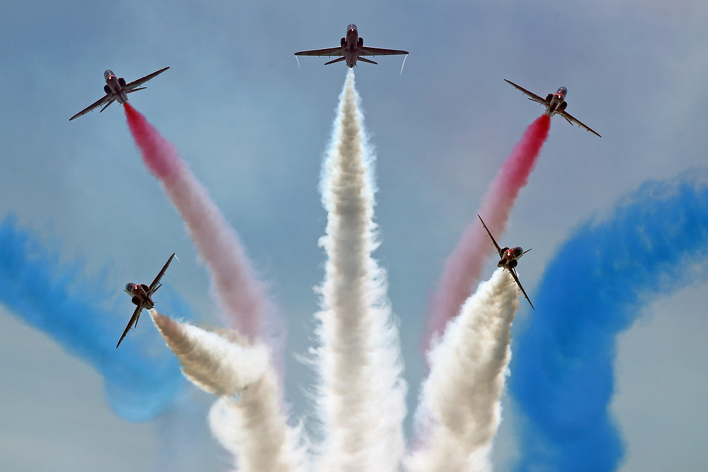 . The Red Arrows display team perform over Southsea Common at the end of a commemoration service of the D-Day landings on June 5, 2014 in Portsmouth, England.  (Photo by Dan Kitwood/Getty Images)