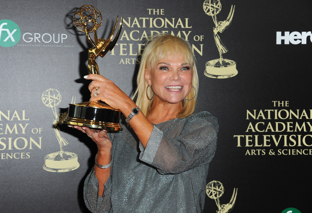 . Linda Bell Blue poses in the press room with the award for outstanding entertainment news program for ìEntertainment Tonightî at the 41st annual Daytime Emmy Awards at the Beverly Hilton Hotel on Sunday, June 22, 2014, in Beverly Hills, Calif. (Photo by Richard Shotwell/Invision/AP)