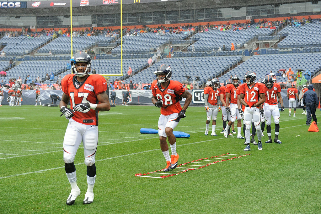 . Denver Broncos wide receiver Demaryius Thomas (88) runs through drills on day six of the Denver Broncos 2014 training camp July 30, 2014 at Sports Authority Field at Mile High Stadium.  (Photo by John Leyba/The Denver Post)
