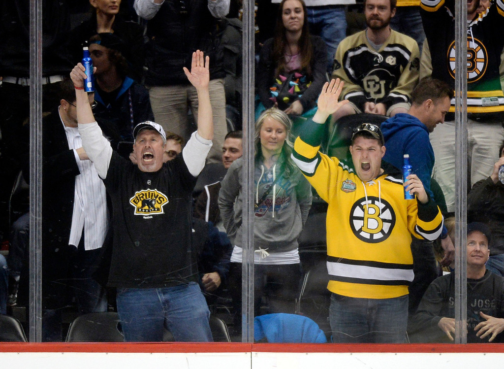 . Bruins fans celebrated the win. The Boston Bruins blanked the Colorado Avalanche 2-0 at the Pepsi Center Friday night, March 21, 2014. (Photo by Karl Gehring/The Denver Post)