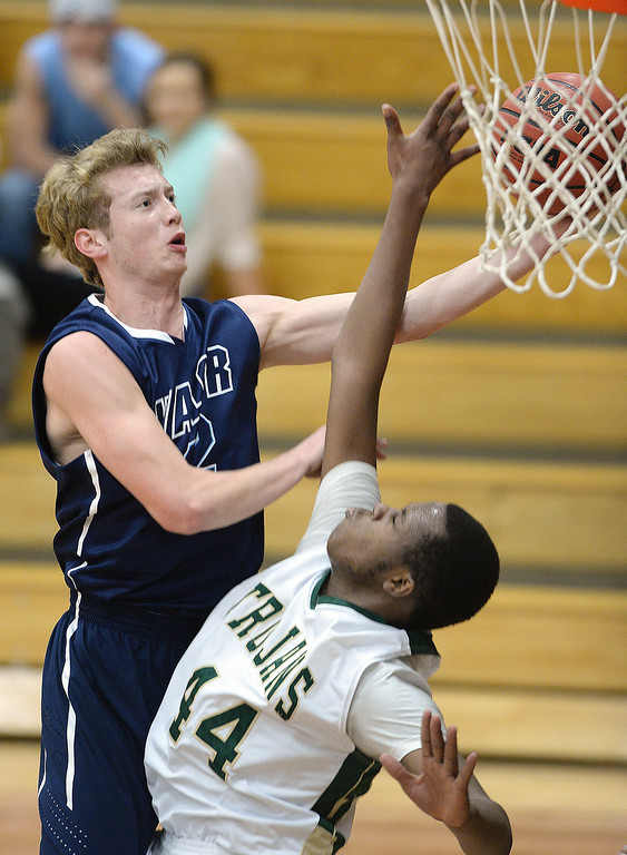 . Valor senior Chase Foster (22) went to the bucket guarded by Aurora Central sophomore Chris Porter (44) in the first half. The Valor Christian High School boy\'s basketball team defeated Aurora Central 60-52 Wednesday night, January 8, 2014. Photo By Karl Gehring/The Denver Post