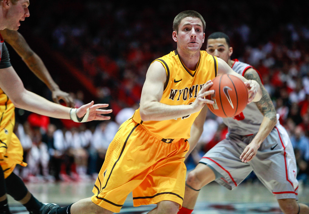 . Wyoming\'s Jack Bentz passes the ball away while being defended by New Mexico\'s Alex Kirk, left,  during the second half of their NCAA college basketball game in Albuquerque, N.M., Saturday, March 2, 2013. New Mexico won 53-42. (AP Photo/ Craig Fritz)