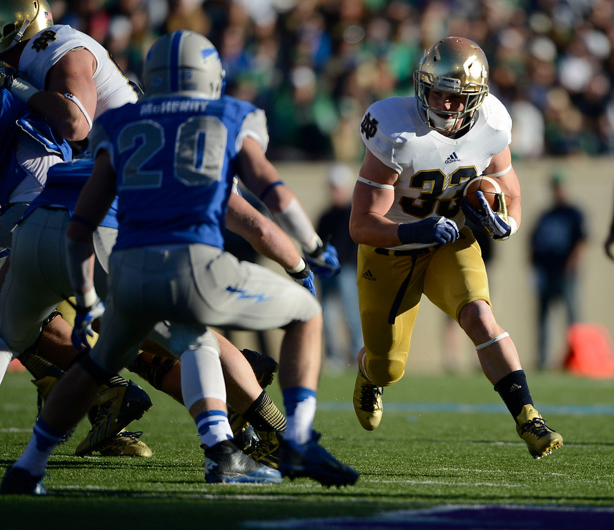 . COLORADO SPRINGS, CO - OCTOBER 26: Notre Dame RB, Cam McDaniel, looks for running room against Air Force DB, Gavin McHenry, at Falcon Stadium, Saturday afternoon, October 26, 2013. (Photo By Andy Cross/The Denver Post)