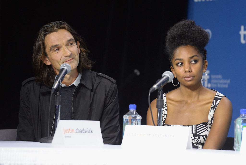 ". Director Justin Chadwick and actress Lindiwe Matshikiza speak onstage at ""Mandela: Long Walk To Freedom\"" Press Conference during the 2013 Toronto International Film Festival at TIFF Bell Lightbox on September 8, 2013 in Toronto, Canada.  (Photo by Jason Merritt/Getty Images)"