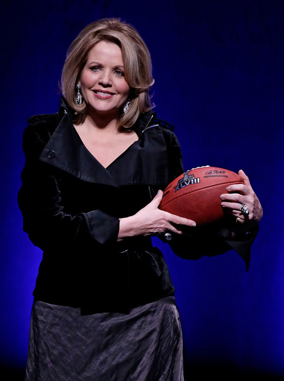 . Grammy award winning soprano, Renee Fleming, poses with a football at a news conference for the Super Bowl LXVIII in New York, New York, USA, 30 January 2014.   EPA/JASON SZENES